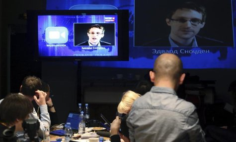 Journalists listen to a speech and a question posed by former U.S. spy agency NSA contractor Edward Snowden, at a media centre during Russia