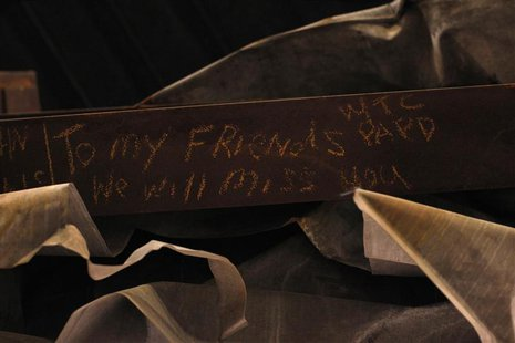 "A message is seen on the bottom of the ""Cross"", intersecting steel beams found in the rubble of 6 World Trade Center that was destroyed on S"