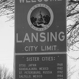 A Lansing City Limits sign at Michigan Avenue which connects Lansing and East Lansing By RP Norris (Lansing Sign  Uploaded by xnatedawgx) [CC-BY-SA-2.0 (http://creativecommons.org/licenses/by-sa/2.0)], via Wikimedia Commons