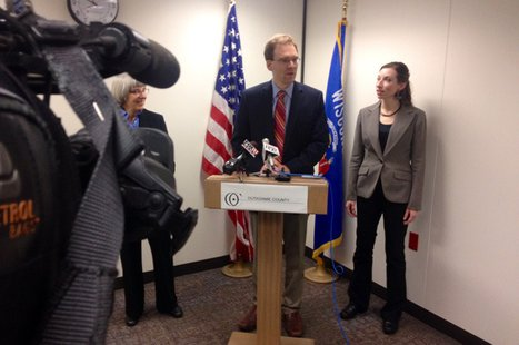 Outagamie County Executive Tom Nelson introduces interim emergency management director Christina Muller (right), April 30, 2014, at the county administration building in Appleton. (Photo from: FOX 11)