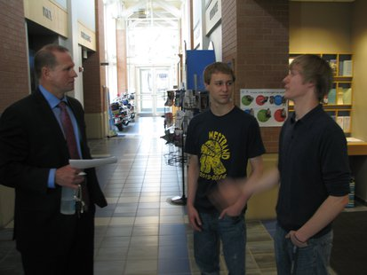 Wausau Police Chief Jeff Hardel, Wausau West Students John Mills (Center) and Sam Ably (Right)