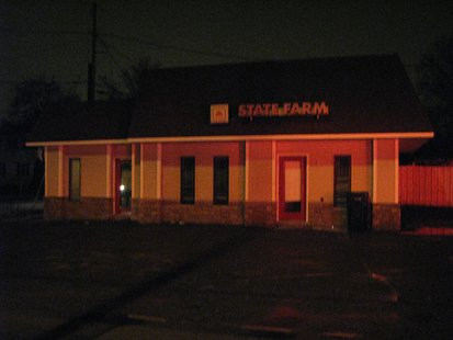 State Farm Insurance office-Wausau in the glow of emergency lights from Wausau Fire Department trucks