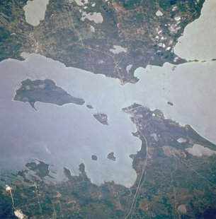"Straits of Mackinac, Michigan, U.S.A. October 1994. South is up. (Photo from: By Image Science and Analysis Laboratory, NASA-Johnson Space Center. ""The Gateway to Astronaut Photography of Earth. [Public domain], via Wikimedia Commons),"