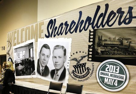 A billboard welcoming Berkshire Hathaway shareholders, displays a vintage picture of Chairman Warren Buffett (L) and Vice Chairman Charlie M