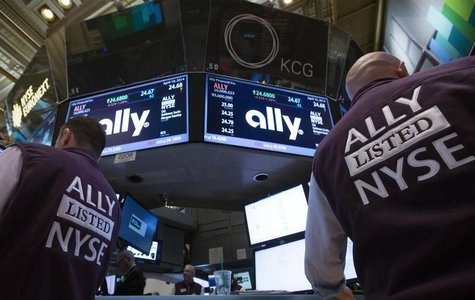 Traders work at the Post that trades Ally Financial Inc. following the IPO on the floor of the New York Stock Exchange April 10, 2014. REUTE