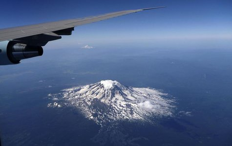 Mt. Saint Helens is seen under the right wing of Air Force One while heading away from Seattle in Washington, July 25, 2012. REUTERS/Larry D