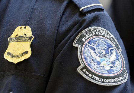 A U.S. Customs and Border Protection arm patch and badge is seen at Los Angeles International Airport, California February 20, 2014. REUTERS