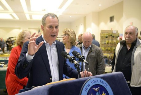 New York Attorney General Eric Schneiderman speaks to reporters during the New Eastcoast Arms Collectors Associates Arms Fair at the Saratog