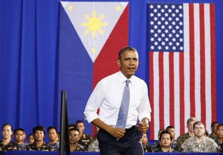 U.S. President Barack Obama walks out to speak to military troops at the Fort Bonifacio Gymnasium in Manila, April 29, 2014. Obama said a ne