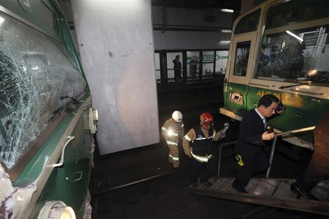 Damaged subway trains are seen at a subway station in Seoul May 2, 2014. REUTERS/Park Dong-ju/Yonhap