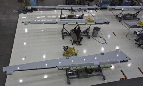 A worker assembles a wing flap for the Boeing 737-900 at their operations in Renton, Washington, October 18, 2012. REUTERS/Andy Clark