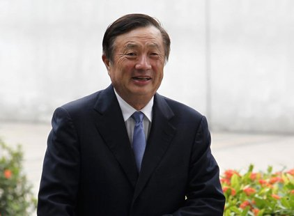 Huawei CEO and founder Ren Zhengfei walks inside Huawei's headquarters in the southern Chinese city of Shenzhen, Guangdong province, in this