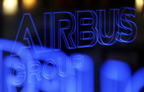 The logo of Airbus Group is reflected in a window during the Airbus Group 2013 annual results presentation in Toulouse February 26, 2014. RE