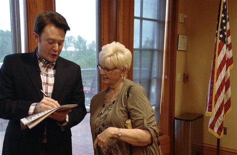Democratic nominee Clay Aiken signs an autograph for a constituent after a campaign forum in Cary, North Carolina, April 28, 2014. REUTERS/C