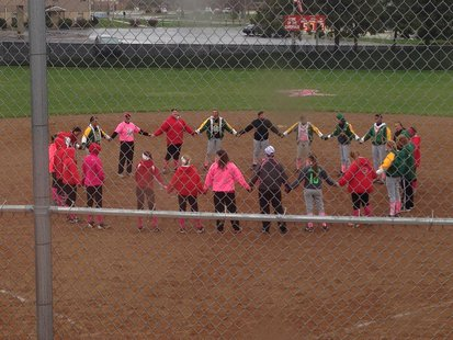 "Coldwater and Pennfield softball players during Coldwater's ""Strike Out Cancer"" night, May 1, 2014"
