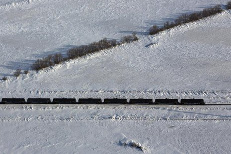 An aerial view shows a train making its way along the Burlington Northern Santa Fe (BNSF) rail line outside of Williston, North Dakota March