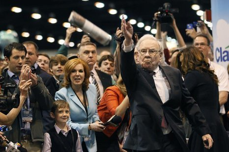 Berkshire Hathaway CEO Warren Buffett throws a newspaper during a competition at a trade show, at the company's annual meeting in Omaha, Neb