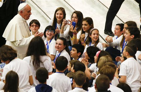 "Pope Francis talks with children during a special audience with members of the ""Catholic Action"" in Paul VI hall at the Vatican May 3, 2014."