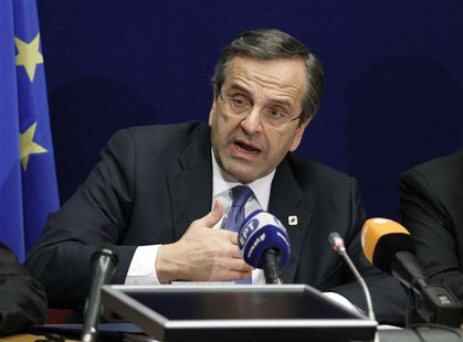 Greece's Prime Minister Antonis Samaras holds a news conference at the end of a European Union leaders summit in Brussels December 14, 2012.