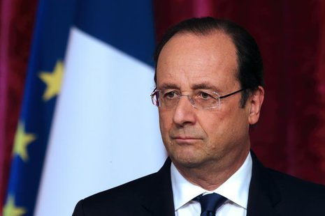 French President Francois Hollande pauses as he attends a news conference at the Elysee Palace in Paris, April 29, 2014. REUTERS/Philippe Wo