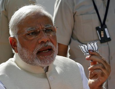 Hindu nationalist Narendra Modi, the prime ministerial candidate for India's main opposition Bharatiya Janata Party (BJP), holds a lotus cut