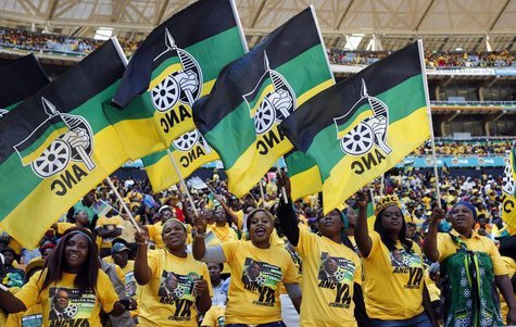 Supporters of South Africa's President Jacob Zuma's ruling African National Congress (ANC) cheer during their party's final election rally i