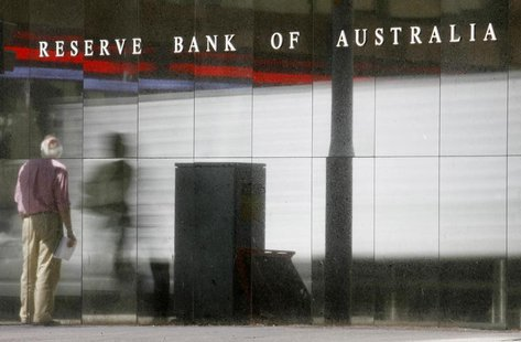 A man is reflected in the Reserve Bank of Australia (RBA) building in Central Sydney December 2, 2008. REUTERS/Daniel Munoz