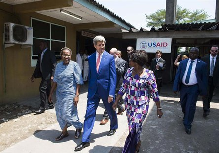 U.S. Secretary of State John Kerry (C) walks alongside Hospital Director Dolores Nembunzu (R) and Sister Mary Joseph (L) at the Fistula Clin