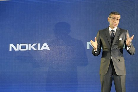 Nokia CEO Rajeev Suri speaks during a news conference to announce its first quarter earnings in Espoo April 29, 2014. REUTERS/Heikki Saukkom