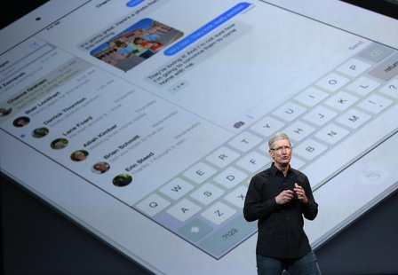 Apple Inc CEO Tim Cook speaks on stage about the new iPad during an Apple event in San Francisco, California October 22, 2013 file photo. RE
