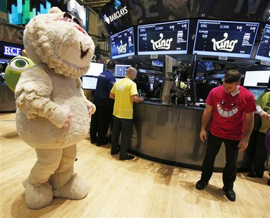 "A mascot dressed as a character from the mobile game ""Candy Crush Saga"" walks the floor of the New York Stock Exchange during the IPO of Mob"