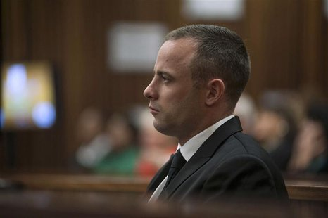 Olympic and Paralympic track star Oscar Pistorius sits in the dock in the North Gauteng High Court in Pretoria May 5, 2014. REUTERS/Ihsaan H