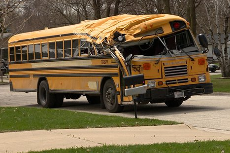 A school bus is seen on Aspen Ln. in Green Bay May 5, 2014, after hitting a tree. (Photo from: FOX 11).