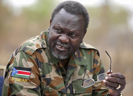 South Sudan's rebel leader Riek Machar speaks to rebel General Peter Gatdet Yaka (not seen) in a rebel controlled territory in Jonglei State