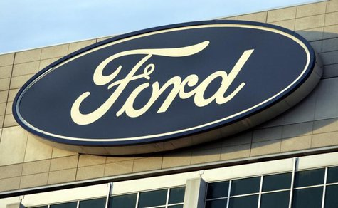 The Ford Motor Co's logo is seen on top of the Ford Motor Company World Headquarters in Dearborn, Michigan, October 26, 2009. REUTERS/Rebecc