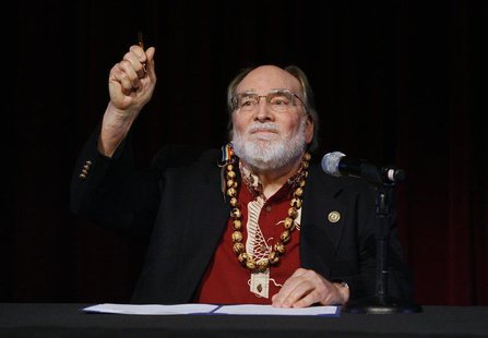 Hawaii Governor Neil Abercrombie holds up the pen after signing Senate Bill 1, allowing same sex marriage to be legal in the state, in Honol