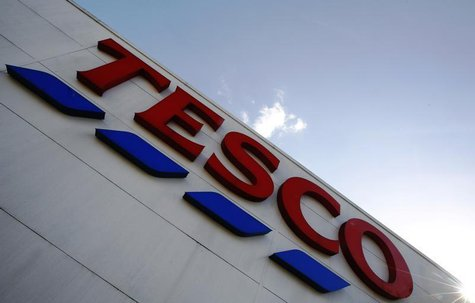A store sign is seen outside a Tesco supermarket in London April 15, 2014. REUTERS/Luke MacGregor