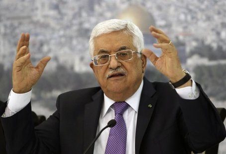 Palestinian President Mahmoud Abbas gestures as he meets Palestinian businessmen at his office in the West Bank city of Ramallah April 29, 2