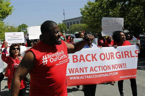 Protesters march in support of the girls kidnapped by members of Boko Haram in front of the Nigerian Embassy in Washington May 6, 2014. REUT