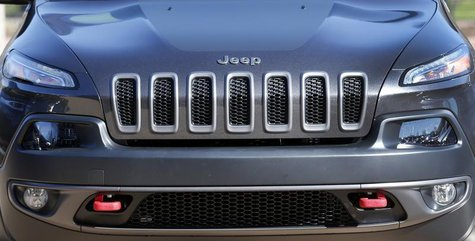 The front grill of a 2014 Chrysler Jeep Cherokee Trailhawk is seen on display outside Chrysler World Headquarters during the FCA Investors D