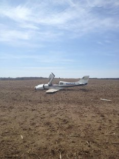 A small plane crashes in a farm field in the Marinette County Town of Stephenson on May 6, 2014. (Photo from: Marinette County Sheriff's Department).
