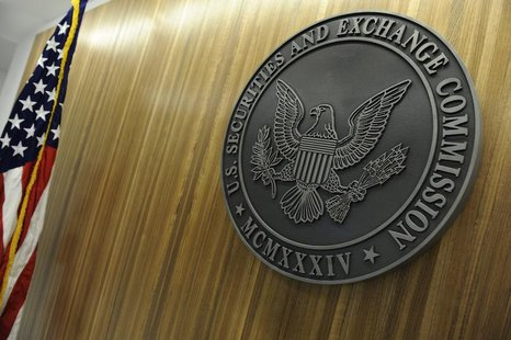 The seal of the U.S. Securities and Exchange Commission hangs on the wall at SEC headquarters in Washington, June 24, 2011. REUTERS/Jonathan