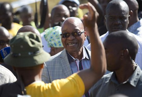 South African President Jacob Zuma greets supporters of African National Congress after voting at a voting station in the Nkandla district M