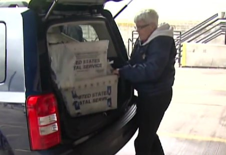 File photo of helping with the Stamp Out Hunger Food Drive in Brown County. (Photo from: FOX 11/YouTube).