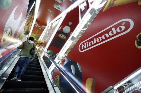 A man rides an escalator past Nintendo Co advertisements at an electronics retail store in Tokyo May 7, 2014. REUTERS/Toru Hanai