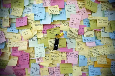 A yellow ribbon dedicated to missing and dead passengers of sunken passenger ship Sewol is seen among messages written for the victims outsi