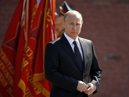 Russian President Vladimir Putin takes part in a wreath-laying ceremony by the Kremlin wall on the eve of the Victory Day celebrations in ce