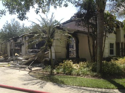 A house owned by former tennis pro James Blake is seen after a fire, in this handout photograph provided by Hillsborough Fire Rescue in Tamp