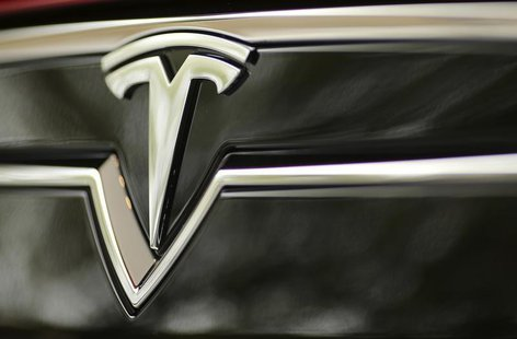 A Tesla Motors logo is shown on a Tesla Model S at a Tesla Motors dealership at Corte Madera Village, an outdoor retail mall, in Corte Mader