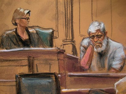 Abu Hamza al-Masri (R), the radical Islamist cleric facing U.S. terrorism charges, gets emotional while giving testimony in Manhattan federa